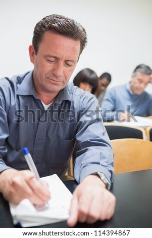 Man taking notes during the lesson - stock photo