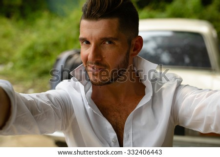 Man taking picture of himself - stock photo