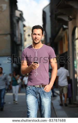 Man talking on phone to the streets - stock photo