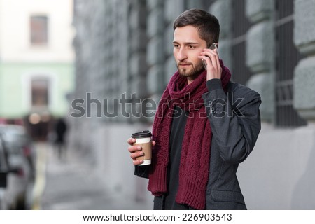 man talking on the phone outdoors - stock photo