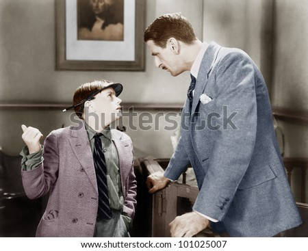 Man talking to a young boy reporter - stock photo