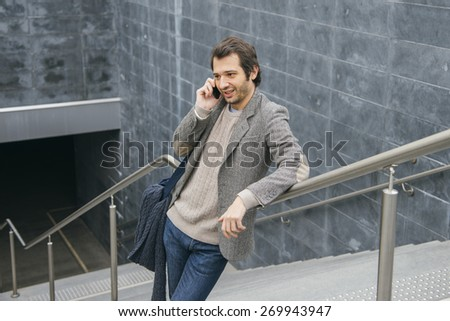 man talking with smartphone in urban city - stock photo