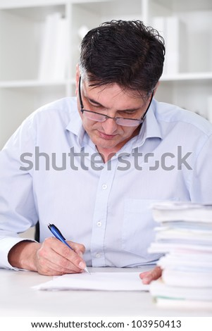 man teacher professor reading concentrated and examine tests - stock photo