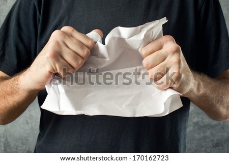 Man tearing contract paper. Bad ideas or project mistakes concept. - stock photo