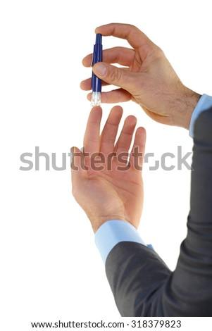 Man testing his blood glucose level,isolated on white - stock photo