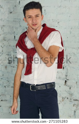 Man think. Thoughtful handsome male. Young handsome man doubting, he is over gray background.  - stock photo