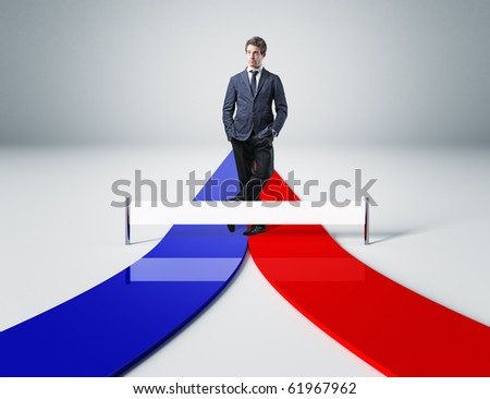 man thinking about important decision on blue and red path - stock photo