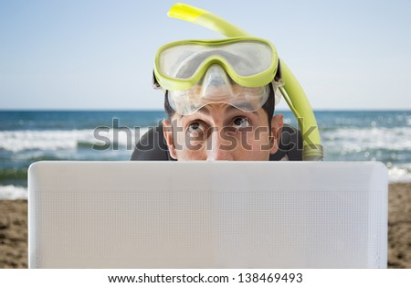 man thinking he travels to on your next vacation on the beach - stock photo