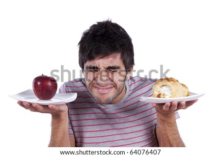 man thinking what to eat between an apple and a cake (isolated on white) - stock photo
