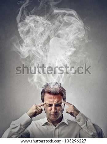 man thinks very intensely - stock photo
