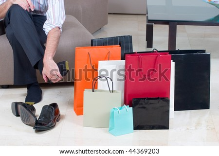 Man tired after shopping - stock photo