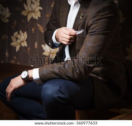 Man touching square pocket - stock photo