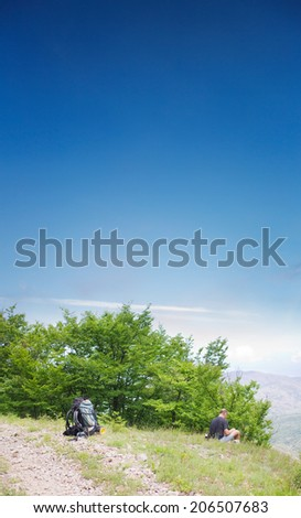 man tourist on mountain road - stock photo