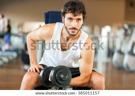 Man training in a gym - stock photo