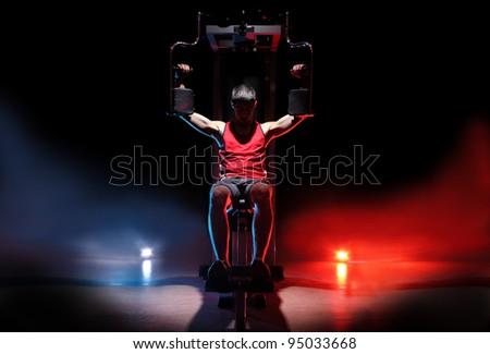 man training on gym isolated on black background - stock photo