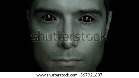 Man trapped in his own eyes, prisoner in his mind, trying to escape from jail, prison - stock photo