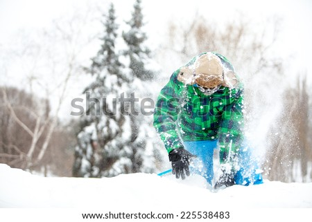 Man traveler hiking in winter in stormy snow weather in motion. rescue concept - stock photo