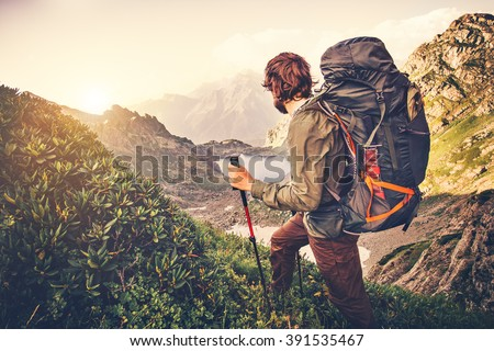 Man Traveler with backpack mountaineering Travel Lifestyle concept lake and mountains on background Summer expedition vacations outdoor  - stock photo