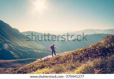 Man Traveler with backpack trekking Travel Lifestyle concept mountains on background Summer vacations activity outdoor aerial view - stock photo