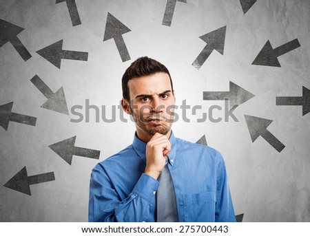 Man trying to choose the right path - stock photo