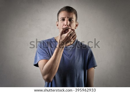 Man trying to whistle - stock photo