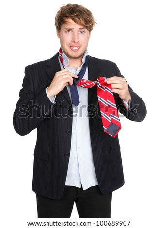 Stock images similar to id 119695933 a man gets upside down while man tying a tie funny man unable to tie his tie trying hard young ccuart Choice Image