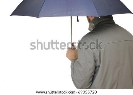Man under an umbrella isolated on white - stock photo