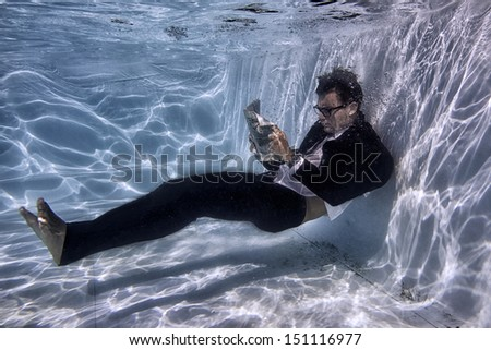 man underwater reading - stock photo