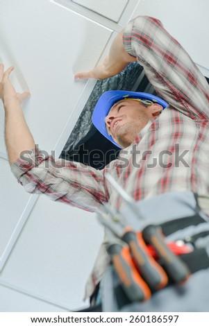 Man up a ladder - stock photo