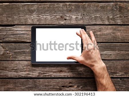 Man use a spread gesture on touch screen of digital tablet. Clipping path included. - stock photo
