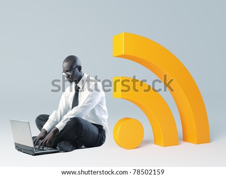 man use laptop and 3d huge rss sign - stock photo