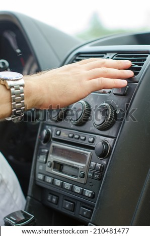 Man using automobile air conditioning system. - stock photo