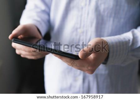 Man using digital tablet - stock photo