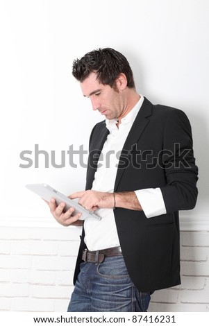 Man using electronic tablet - stock photo