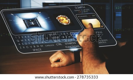 Man using Futuristic Smart Wrist Watch that is projecting a semi-transparent holographic touch screen - stock photo