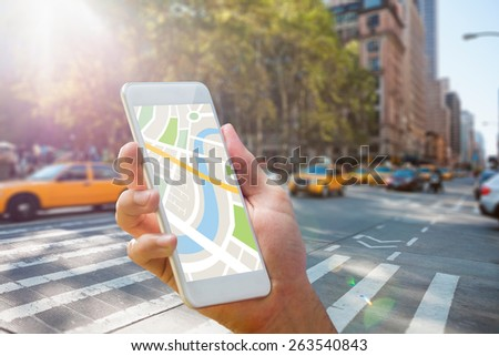 Man using map app on phone against new york street - stock photo