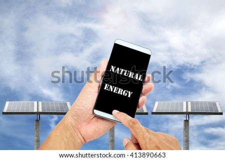 man using mobile smart phone control with Outdoor small solar panel  isolated on sky background ,natural energy concept - stock photo