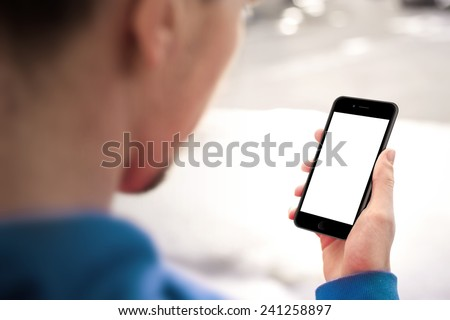 Man using mobile smartphone iphon 6. Shot with third-person view, blank screen - stock photo