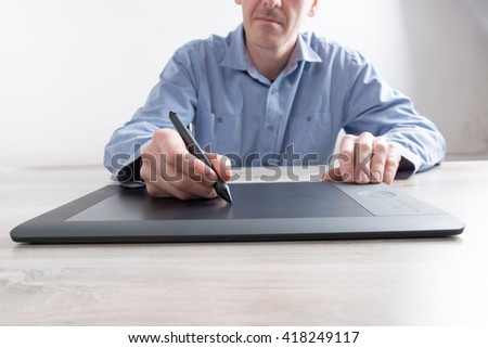 Man using modern graphical tablet  - stock photo