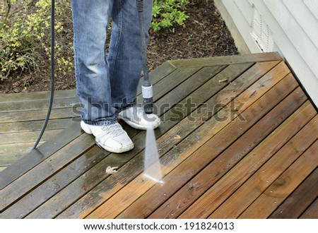 Man Using Power Washer - stock photo