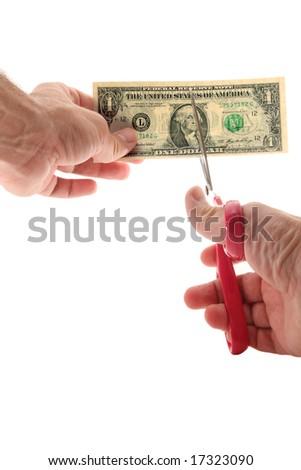 Man using scissors to cut US $1 bill - stock photo