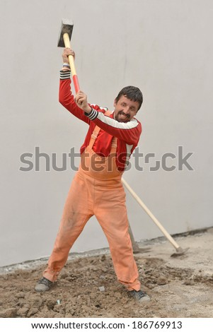 Man using sledge-hammer  - stock photo