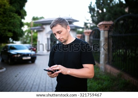 man using smartphone - stock photo