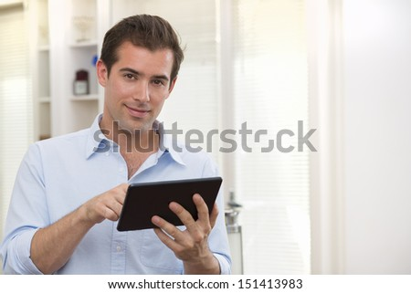 Man using tablet pc indoor - stock photo