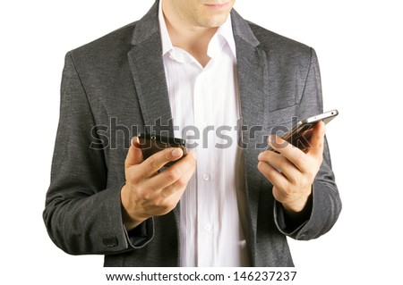 man using two cellphones - stock photo
