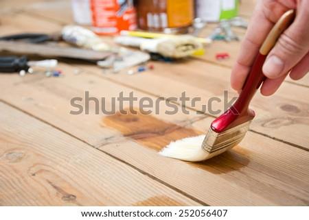 Man varnishing a wood - stock photo