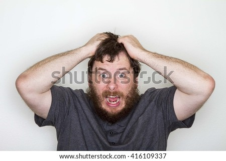 Man very angry at something - stock photo