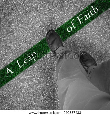 Man walking across a green line with words a leap of faith - stock photo