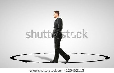 man walking in a circle in room - stock photo