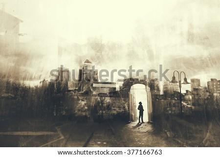 Man walking in a mystic dark city - stock photo